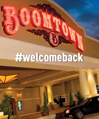 "exterior of Boomtown Casino Bossier City with text ""#welcomeback"""